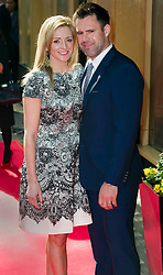 © Licensed to London News Pictures 09/02/2011 London, UK. .Gabby Logan and husband Kenny arrive at the Waldorf Hotel, London for the seventh Tesco Mum of the Year Awards..Photo credit : Simon Jacobs/LNP