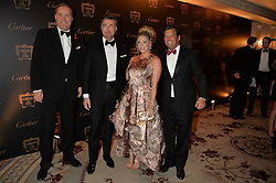 Left to right, the HON.HARRY HERBERT, LAURENT FENIOU and guests at the 26th Cartier Racing Awards held at The Dorchester, Park Lane, London on 8th November 2016.
