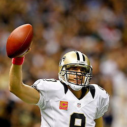 October 7, 2012; New Orleans, LA, USA; New Orleans Saints quarterback Drew Brees (9) celebrates after throwing a touchdown to wide receiver Devery Henderson (not pictured) to break the NFL record for consecutive games throwing a touchdown at 48 games eclipsing a record once held by Johnny Unitas during the first quarter of a game against the San Diego Chargers at the Mercedes-Benz Superdome. Mandatory Credit: Derick E. Hingle-US PRESSWIRE
