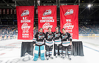 KELOWNA, CANADA - SEPTEMBER 25: Jackson Whistle #1, Gage Quinney #20, Cole Linaker #26 and Tyson Baillie #24 raise the B.C. Division, Western Conference Division and WHL championship banners at their home opener against the Kamloops Blazers on September 25, 2015 at Prospera Place in Kelowna, British Columbia, Canada.  (Photo by Marissa Baecker/Getty Images)  *** Local Caption ***  Jackson Whistle; Gage Quinney; Cole Linaker; Tyson Baillie;