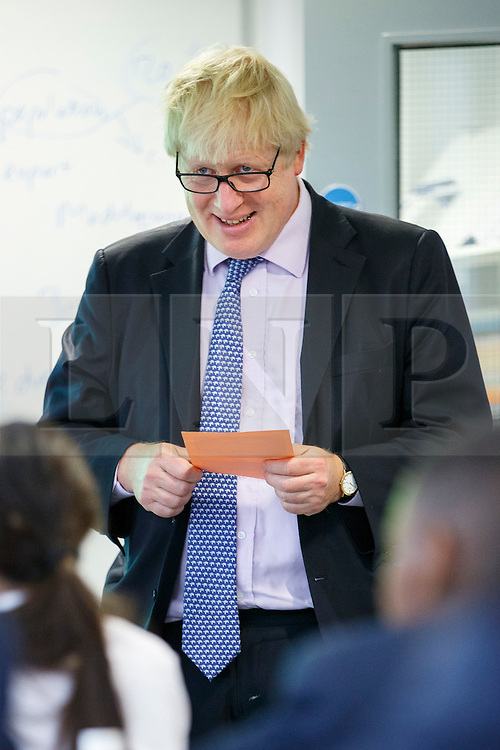 © Licensed to London News Pictures. 23/06/2015. London, UK. The Mayor of London Boris Johnson take part in a history lesson with pupils during his visit to Michaela Community School in Wembley, north-west London on Tuesday, June 23, 2015.  Photo credit: Tolga Akmen/LNP