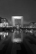 Paris, Arch of La defense, modern district , reflection in a water bassin/ quartier de la defense