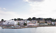 The Royal Yacht Squadron at the entrance to the Medina River in Cowes on the Isle of Wight. The famous club is 200 years old in 2015.<br /> Picture date: Monday August 17, 2015.<br /> Photograph by Christopher Ison &copy;<br /> 07544044177<br /> chris@christopherison.com<br /> www.christopherison.com