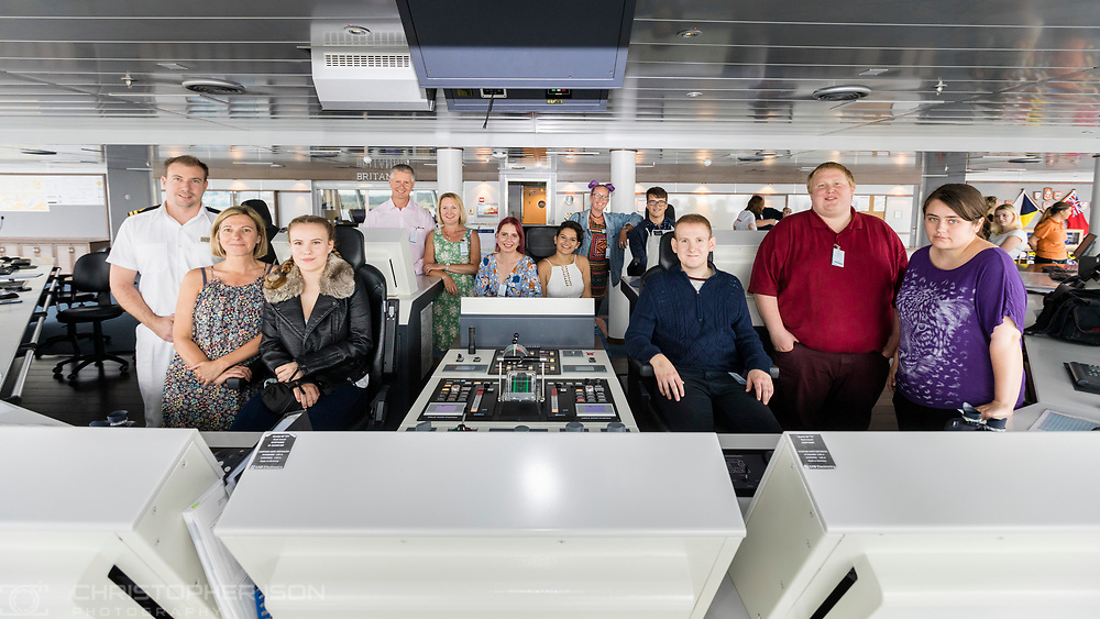 Staff, families and patients supported by Teenage Cancer Trust pictured on the bridge of Britannia in Southampton during a tour of the ship to celebrate P&amp;O Cruises raising &pound;100,000. <br />
