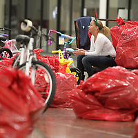 Adam Robison | BUY AT PHOTOS.DJOURNAL.COM<br /> Danielle Hatchett, of Tupelo, a volunteer with White Hill Baptist Church, takes a break from loading Salvation Army Angel Tree gifts as she sits on her cart in Building 5 of the Tupelo Furniture Market Friday morning.