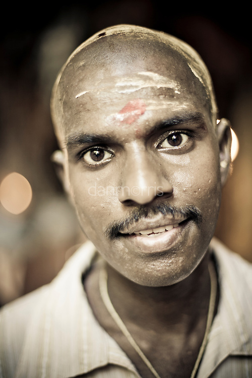 Hindu man after emerging from ceremony in Batu Caves, Kuala Lumpur