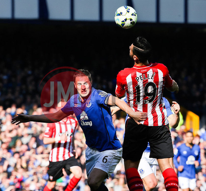 Southampton's Graziano Pelle wins a header against Everton's Phil Jagielka  - Photo mandatory by-line: Matt McNulty/JMP - Mobile: 07966 386802 - 04/04/2015 - SPORT - Football - Liverpool - Goodison Park - Everton v Southampton - Barclays Premier League