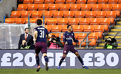 Arsenal's Joe Willock (right) celebrates scoring his side's second goal of the game during the Emirates FA Cup, third round match at Bloomfield Road, Blackpool.