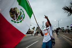 A Morena' AMLO supporter with a mexican flag.