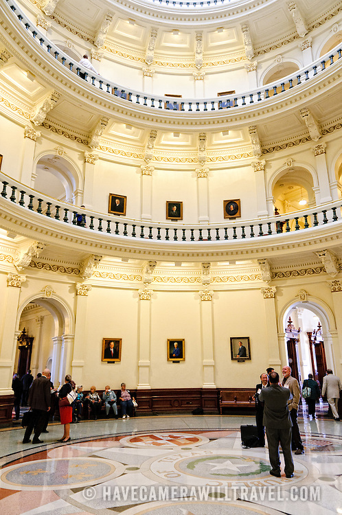 Visitors stand in the central atrium under the dome of the Texas State Capitol in Austin, Texas.