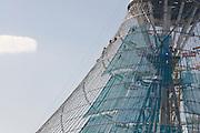 Construction workers  climbing in Khan Shatyry Entertainment Center, Astana, Kazakhstan