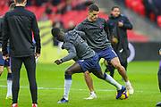 Tottenham Hotspur midfielder Erik Lamela (11) warms up with Tottenham Hotspur defender Davinson Sanchez (6) prior to the Premier League match between Tottenham Hotspur and Bournemouth at Wembley Stadium, London, England on 26 December 2018.