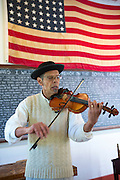 Violinist playing violin at Vermilionville history museum of Acadian, Creole, Native American cultures, Lafayette, Louisiana USA