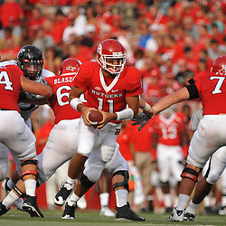 Sep 7, 2009; Piscataway, NJ, USA; Rutgers quarterback Domenic Natale (11) moves in the pocket during the first half of Rutgers' 47-15 loss to Cincinnati in NCAA college football at Rutgers Stadium.