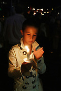 Kai Ballardin is the next generation of Elvis Fans. Thousands of fans turn out for the candle light vigil at Graceland in Memphis, Tennessee that marks the 41st anniversary of the death of Elvis Presley.