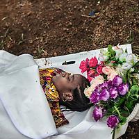 21/04/2014. Gueckedou. Guin&eacute;e Conakry.  <br /> <br /> Deux jours apr&egrave;s avoir &eacute;tait test&eacute;e positive &agrave; l'Ebola, Finda Marie Kamano d&eacute;c&egrave;de.<br /> <br /> Les sanitaires s'habillent pour pr&eacute;senter la d&eacute;funte &agrave; sa famille et leur assurer que c'est bien elle qui est dans le sac mortuaire herm&eacute;tique.<br /> <br /> Two days after was tested positive for Ebola, Finda Marie Kamano dies. <br /> <br /> The sanitary dress to present the defunct to her family and to assure them that it is she who is in the sealed body bag.<br /> <br /> &copy;Sylvain Cherkaoui/Cosmos/MSF