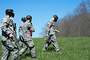 Cadets get in position for a game of capture the flag against their superiors after the Airforce ROTC's Mobile Exercise on April 16, 2016. Photo by Ohio University / Kaitlynn Stone