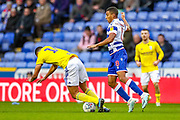Reading midfielder Andy Rinomhota (8) tussles with Birmingham City defender Jake Clarke-Salter (14) which results in an injury as he fell during the EFL Sky Bet Championship match between Reading and Birmingham City at the Madejski Stadium, Reading, England on 7 December 2019.