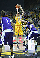 December 30, 2011: Iowa Hawkeyes center Bethany Doolittle (51) puts up a shot as Northwestern Wildcats forward/center Dannielle Diamant (31) defends during the NCAA women's basketball game between the Northwestern Wildcats and the Iowa Hawkeyes at Carver-Hawkeye Arena in Iowa City, Iowa on Wednesday, December 30, 2011.