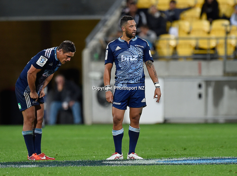 Benji Marshall (R with Jackson Willison of the Blues stand dejected after a Hurricanes try during the Super Rugby - Hurricanes v Blues match at the Westpac Stadium in Wellington on Friday the 18th of April 2014.  Photo by Marty Melville/Photosport.co.nz