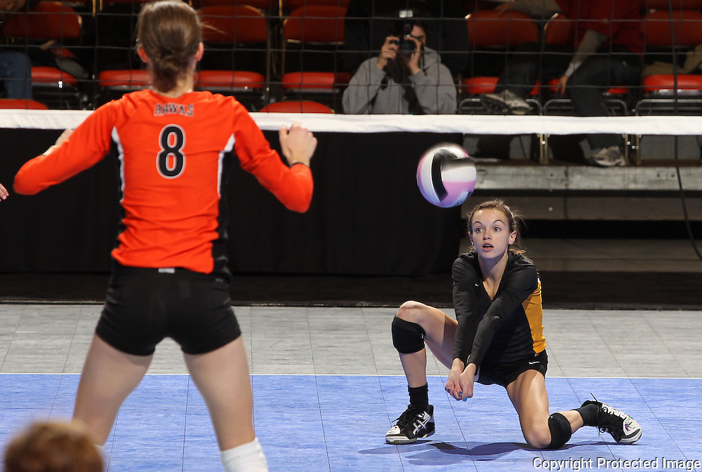 Waverly-Shell Rock's Katie Blake (3) digs for a ball as West Delaware's Allison Pasker (8) looks on during the third game of a 3A semifinal in the state volleyball tournament at the U.S. Cellular Center at 370 1st Ave E on Friday afternoon, November 12, 2010. (Stephen Mally/Freelance)