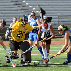Springfield goalie Ally Scanlon (25) kicks the ball out of the box surrounded by her teammates and Strath Haven's Megan Murray (19) during the Springfield at Strath Haven girls field hockey game in Nether Providence on Thursday, September 4, 2014.  (Times staff / TOM KELLY IV)