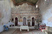 Inside the Byzantine Church of Panagia Kasopitra, with its fresco painted iconostasis, Himare, Vlore, Albania. The image of the Virgin in this church is said to be miraculous, bringing rain to the area in times of drought. Himare is a town in Vlore in the Albanian Riviera on the Ionian Coast, Southern Albania. Picture by Manuel Cohen