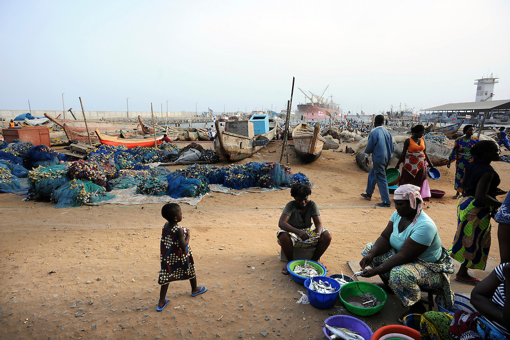 A group of Beninese women sell fish along the lagoon of Ganvie in Cotonou, Benin on March 1, 2008..
