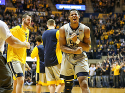 Jan 15, 2018; Morgantown, WV, USA; West Virginia Mountaineers forward Sagaba Konate (50) reacts after a timeout during the first half against the Kansas Jayhawks at WVU Coliseum. Mandatory Credit: Ben Queen-USA TODAY Sports
