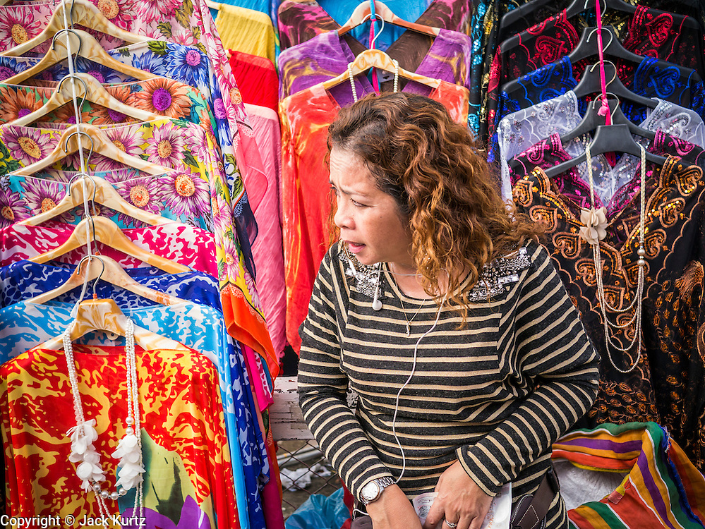 30 MAY 2013 - BANGKOK, THAILAND:  A vendor in Bobae Market in Bangkok. Bobae Market is a 30 year old famous for fashion wholesale and is now very popular with exporters from around the world. Bobae Tower is next to the market and  advertises itself as having 1,300 stalls under one roof and claims to be the largest garment wholesale center in Thailand.    PHOTO BY JACK KURTZ
