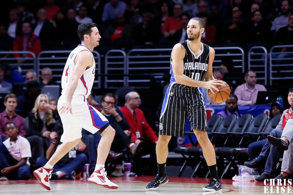 03 December 2014: Orlando Magic guard Evan Fournier (10) looks to pass the ball over Los Angeles Clippers guard J.J. Redick (4) during the Los Angeles Clippers 114-86 victory over the Orlando Magic, at the Staples Center, Los Angeles, California, USA.