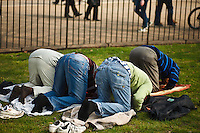 Devout Muslims pray in Hyde Park, London, England.