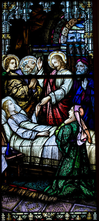 Stained glass image depicting Jesus bringing back to life the daughter of Jairus, as described in Mark 5:35, inside Sacred Heart Church, Sherwood, Wis. (Sam Lucero photo)