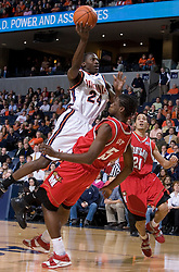 Virginia's Mamadi Diane (24) prepares a shot over Maryland's James Gist (15).  The Cavaliers defeated the #22 ranked Terrapins 103-91 at the John Paul Jones Arena in Charlottesville, VA on January 16, 2007.