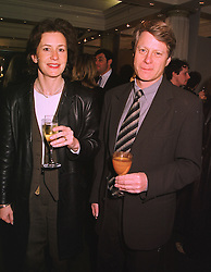 MR & MRS NICK ROSS, he is the TV presenter, at an exhibition of 4th February 1999.MNX 4