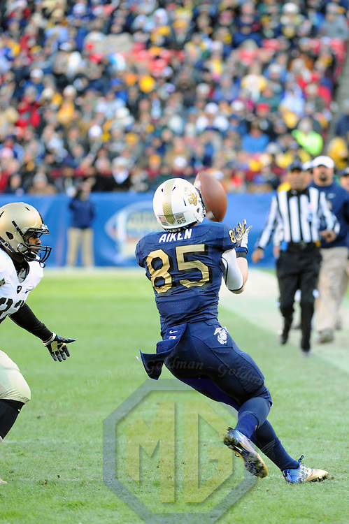 10 December 2011:   Navy Midshipmen wide receiver Matt Aiken (85) in action against Army Black Knights linebacker Nate Combs (22) at Fed Ex field in Landover, Md. in the 112th annual Army Navy game where Navy defeated Army, 27-21 for the 10th consecutive time.