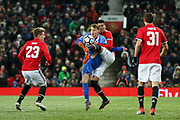 Brighton and Hove Albion midfielder Solomon (Solly) March (20) is tackled by Manchester United Defender Chris Smalling during the FA Cup match between Manchester United and Brighton and Hove Albion at Old Trafford, Manchester, England on 17 March 2018. Picture by Phil Duncan.