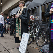 "ALEXANDRIA, VA - MAR1: Pastor Robin Anderson (left) offers ""glitter ashes"" for Ash Wednesday, alongside Pastor Jeanette Leisk (right) who was offering traditional ashes, outside the Braddock Road metro station, in Alexandria, VA, March 1, 2017. Across the country, churches involved with the advocacy group Parity will be giving out ""glitter ashes"" to demonstrate that LGBT people should be included in Christianity.(Photo by Evelyn Hockstein/For The Washington Post)"