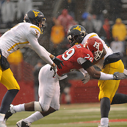 Dec 5, 2009; Piscataway, NJ, USA; Rutgers cornerback Zaire Kitchen (29) tackles West Virginia running back Noel Devine (7) during second half NCAA Big East college football action in West Virginia's 24-21 victory over Rutgers at Rutgers Stadium.
