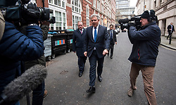 © Licensed to London News Pictures. 08/01/2018. London, UK. New Chairman of the Conservative Party Brandon Lewis BRANDON LEWIS (centre) is mobbed by media as he and other new cabinet members arrive at Conservative Party Headquarters in Westminster, London following a cabinet reshuffle by Prime Minister THERESA MAY. A number of senior moves are expected ahead of a new phase in Brexit negotiations and following the recent loss of Damian Green as First Secretary of State. Photo credit: Ben Cawthra/LNP