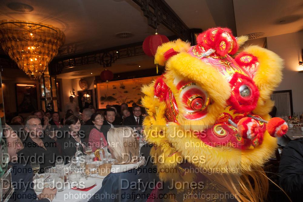 KEVIN SPACEY; TONY BLAIR; CHERIE BLAIR; DRAGON, Chinese New Year dinner given by Sir David Tang. China Tang. Park Lane. London. 4 February 2013.