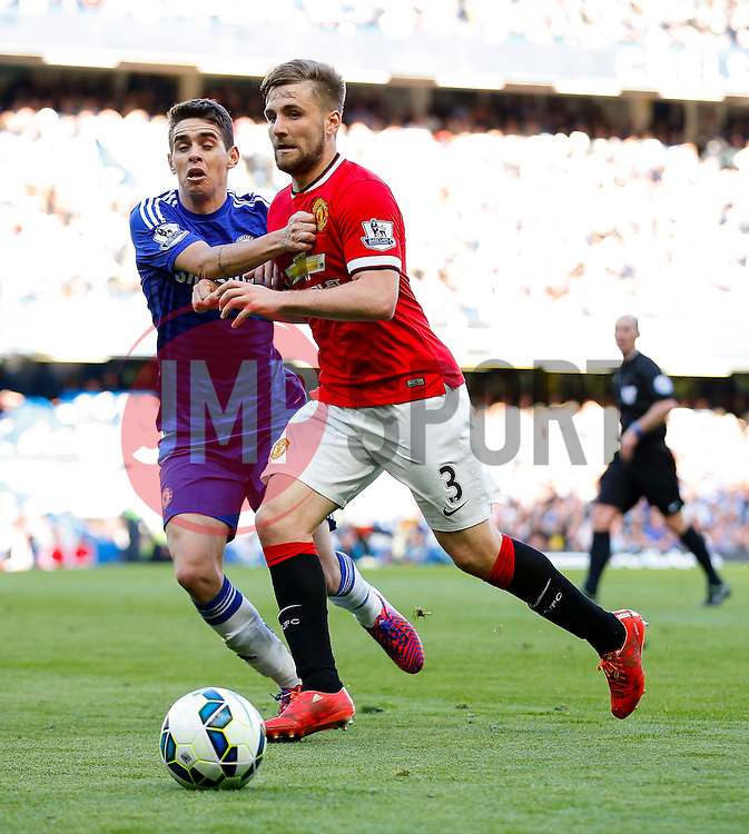 Luke Shaw of Manchester United is challenged by Oscar of Chelsea - Photo mandatory by-line: Rogan Thomson/JMP - 07966 386802 - 18/04/2015 - SPORT - FOOTBALL - London, England - Stamford Bridge - Chelsea v Manchester United - Barclays Premier League.