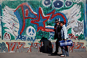 People walk past murals in honor of those killed in Juarez during the drug war consuming the city January 17, 2009. More than 40 people have been killed in violence since the start of the year and 1600 people were killed in Juarez in 2008, making Juarez the most violent city in Mexico.    (Photo by Richard Ellis)