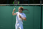 30 June 2018.  The Wimbledon Tennis Championships 2018 held at The All England Lawn Tennis and Croquet Club, London, England, UK.  <br /> <br /> Practice Saturday.<br /> Novak Djokovic practices with David Goffin on No 7 Court.  Pictutred:- David Goffin