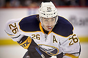 SHOT 3/28/15 7:35:57 PM - The Buffalo Sabres' Matt Moulson #26 lines up during a faceoff against the Colorado Avalanche in their regular season NHL game at the Pepsi Center in Denver, Co. The Avalanche won the game 5-3. (Photo by Marc Piscotty / © 2015)
