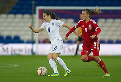 CARDIFF, WALES - Tuesday, August 21, 2014: Wales Natasha Harding battles with England's Karen Carney during the FIFA Women's World Cup Canada 2015 Qualifying Group 6 match at the Cardiff City Stadium. (Pic by Ian Cook/Propaganda)