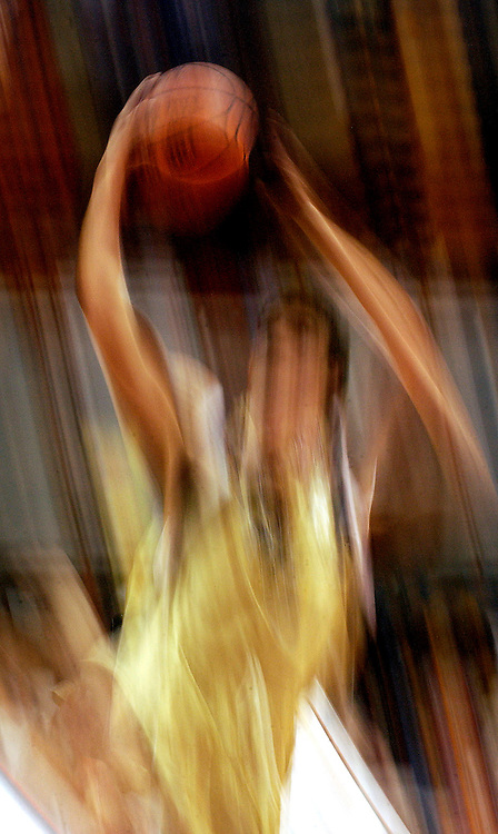 November 11, 2004 / Syracuse, NY / Photo by Mike Roy / A University of Northern Colorado basketball player drives to the basket for a layup during a game against Syracuse University November 11, 2004 at the Carrier Dome, Syracuse, NY.