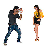Photographer photographing a model on white background