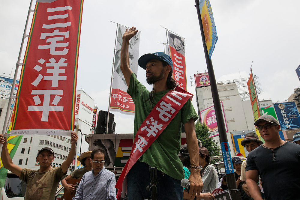 TOKYO, JAPAN - JULY 8 :  Yohei Miyake, Japanese musician and independent candidate for July's House of Councillors elections waves to his supporters during the Upper House election campaign outside of Ikebukuro Station, Tokyo, Japan, on July 8, 2016. The July 10, 2016 Upper house election is the first nation-wide election in Japan after government law changes its voting age from 20 years old to 18 years old. (Photo by Richard Atrero de Guzman/NUR Photo)