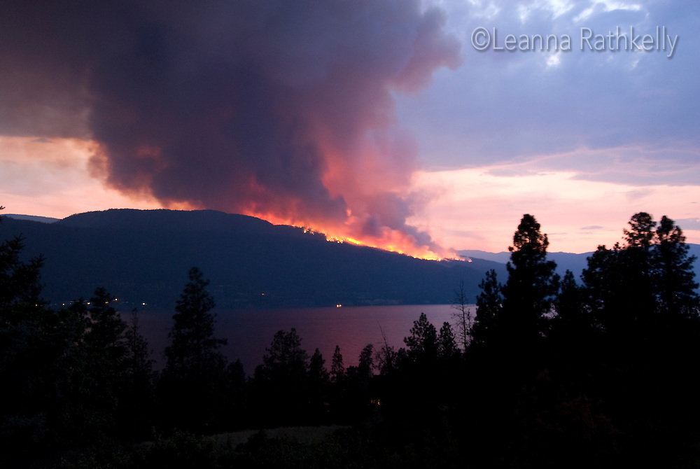 The Terrace Mountain forest fire burns above Okanagan Lake, BC Canada